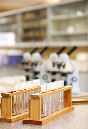 science scientist related images displaying elcectronic microscopes and test tubes in a laboratory or storeroom. strong education research and medical themes