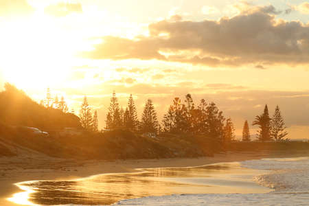 view to Town Beach at Port Macquaruie on the md north coast of NSW New South Wales Australia. Beautiful golden hour sunset at a coastal surf beach. Surf culture environment