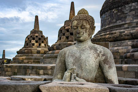 Buddha in a temple with stupas