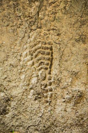 boot footprint on mud floor  photo