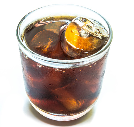 Cola with ice in  cup on white  photo