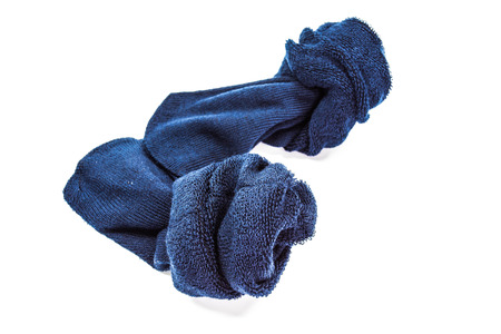 used dirty sock isolated on white  photo