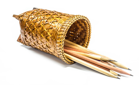 wickerwork: Woven basket and pencil on a white