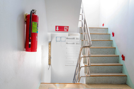 extinguisher: stairwell fire escape in a modern building.