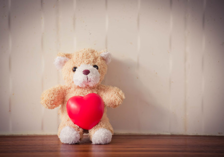 valentine s day teddy bear: teddy Bear with Heart  old grunge ,concept valentine ,vintage retro tone Stock Photo