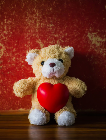 valentine s day teddy bear: teddy Bear with Heart  old grunge background,concept valentine ,vintage retro tone