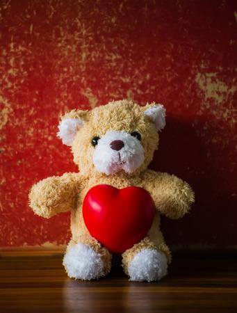 valentine s day teddy bear: teddy Bear with Heart  old grunge background,concept valentine ,vintage retro tone