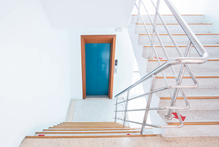 stairwell: stairwell in a modern building with direct access to the elevator.