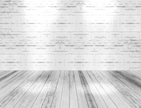 white wood floor: room interior with light shining down on the floor,white brick wall and wood floor background.
