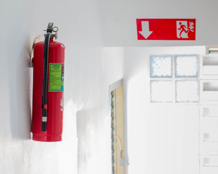 fire hoses: Fire safety in buildings on white cement wall background.
