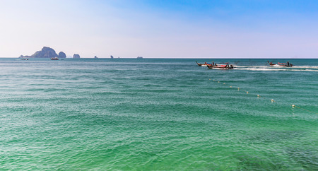 aonang: boat rushing in sea,in summer,in Thailand. Stock Photo