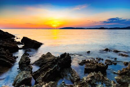 aonang: sunset and beach with rocks in the evening,at aonang krabi,Thailand.
