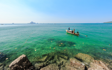 identifiable: Fishermen are fishing in sea, in summer, in Thailand. (Not identifiable). Stock Photo