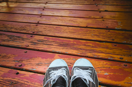 formal wear clothing: Old black shoes  on the wood floor.