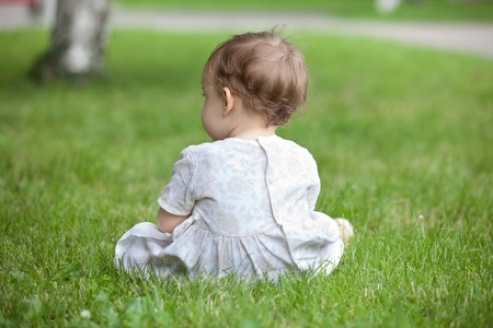 Back shot of an infant in park Stock Photo - 8101837