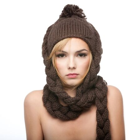 a portrait of a young, blonde woman, with a brown winter hat on her head photo