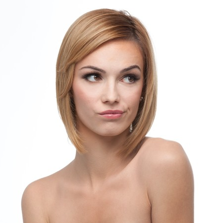 a portrait of a young, blonde woman, looking to the right, with a suspicious expression on her face Stock Photo - 8101824