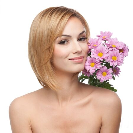 a portrait of a young, blonde woman, having a bouquet of pink flowers next to her face, smiling photo