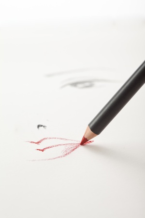 a make-up sketch, drawn on white paper, with a red lip pencil drawing the lips and one eye in the backgrownd photo