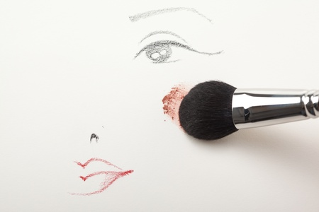 brows: a make-up sketch, drawn on white paper, with a blush brush applying pink powder blush to the cheek Stock Photo
