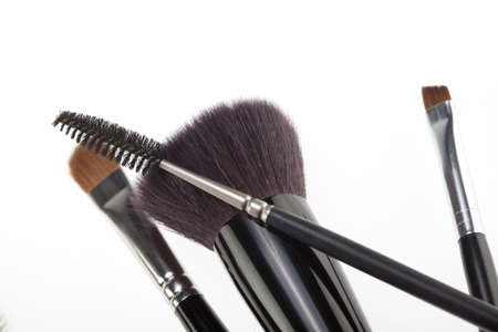 a detail of a make-up brushes composition, in a random position, shot on white background.  photo