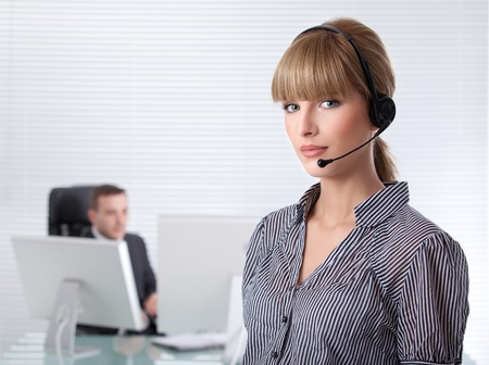 secretary with headphone and her boss in the background Stock Photo - 8259368