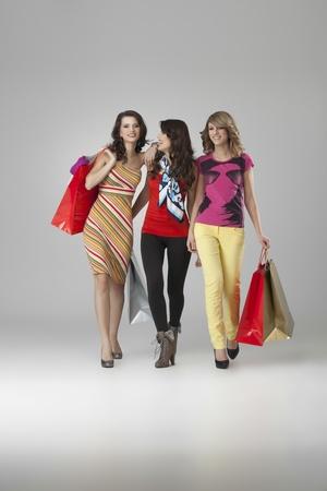 girlfriends looking happy shopping walking photo