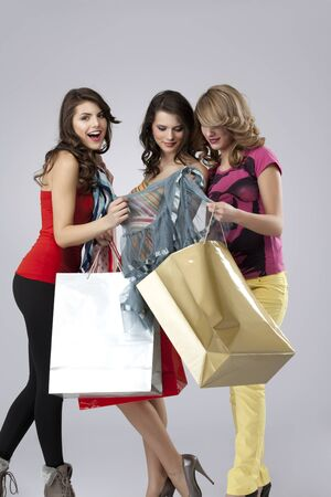 girlfriends looking happy shopping photo