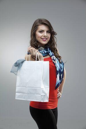 tall girl fashion posing red blouse bag Stock Photo