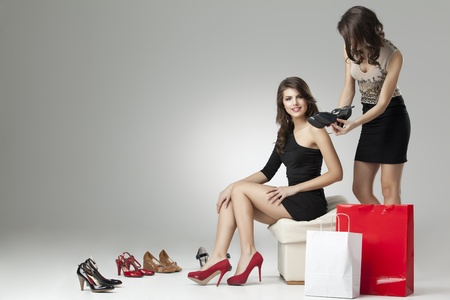 two glamorous women shopping high heels photo