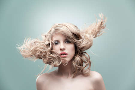 portrait curly blonde wind hair photo