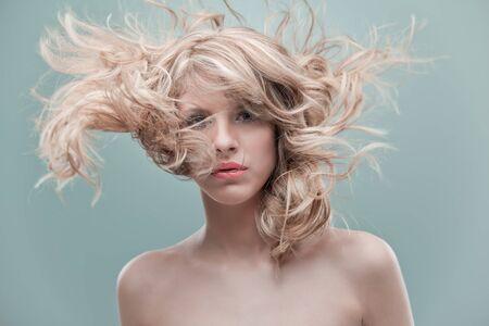 portrait curly blonde wind hair photo