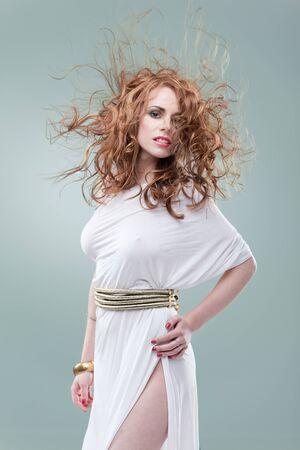 wind hair  greece woman  photo