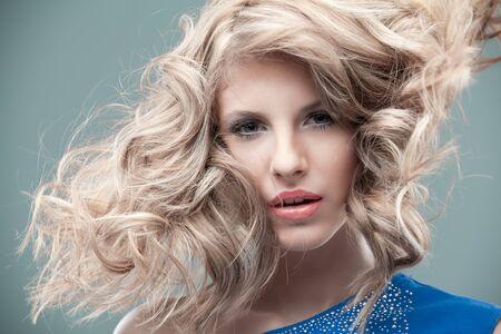 portrait curly blonde looking blue dress photo