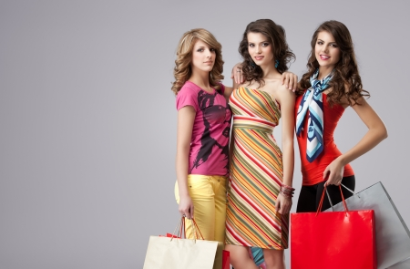 colorful dress: shopping girlfriends posing happy at camera Stock Photo