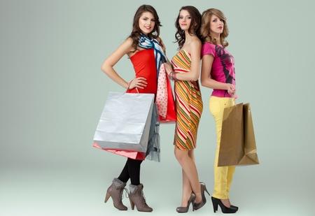 shopping girlfriends posing happy at camera photo