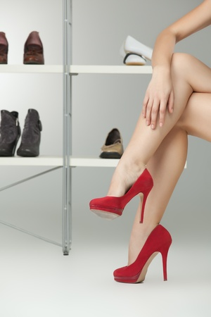 long legs red high heels caucasian woman photo
