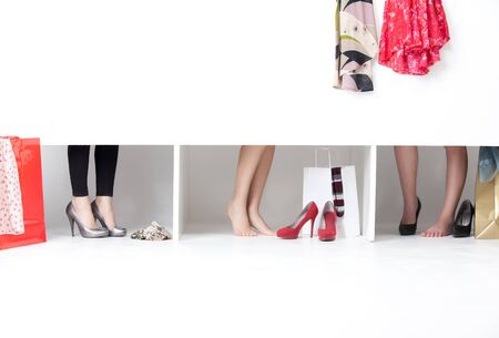 urban fashion: feet on high heels showing from wordrobe Stock Photo