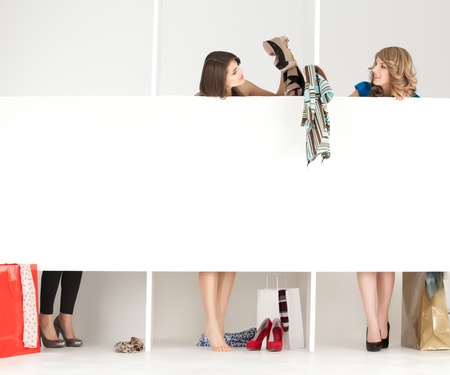 fashion shoes: girls discussing over clothes in shop wordrobe