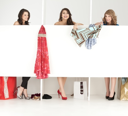 urban fashion: girls discussing over clothes shop wordrobe laughing Stock Photo