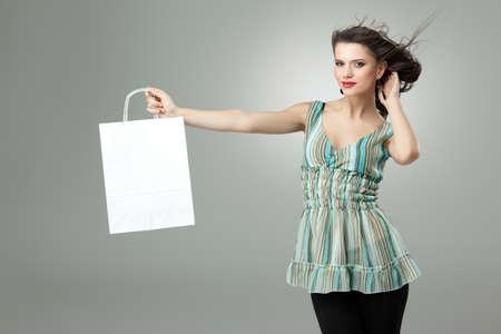 tall brunette woman shopping white bag wind photo