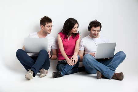 cuus friends looking at laptop Stock Photo - 9667643