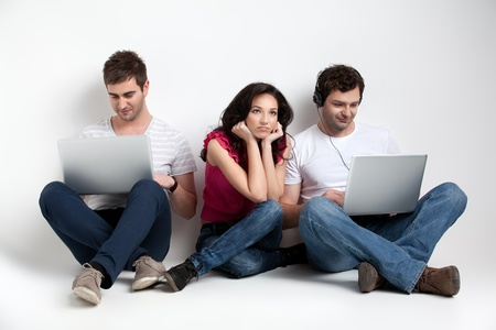 boys looking al laptops, girl bored Stock Photo - 9667693