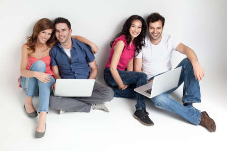 group of carfree beautiful friends with laptops Stock Photo - 9667706