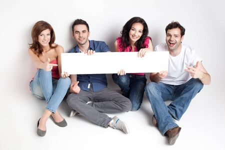 four friends showing a white board Stock Photo - 9667702