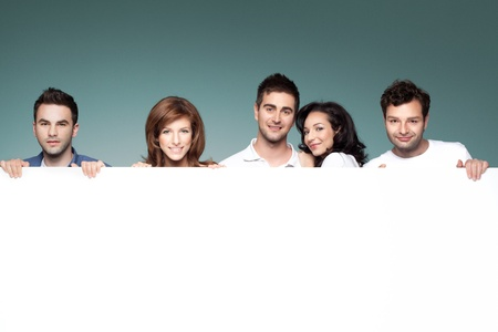 group of funny friends holding a blank banner Stock Photo