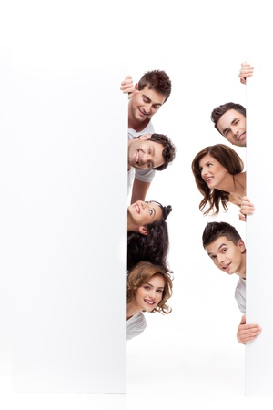 young people smiling behind advertising banner Stock Photo - 9881692