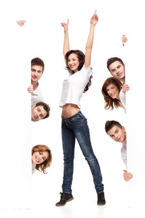 enthusiasm: enthusiastic young woman between white boards friends Stock Photo