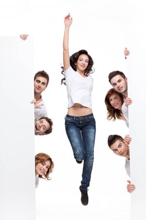 advertising board: enthusiastic young woman between white boards friends Stock Photo