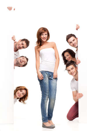 pretty woman between white boards with friends Stock Photo - 9881663